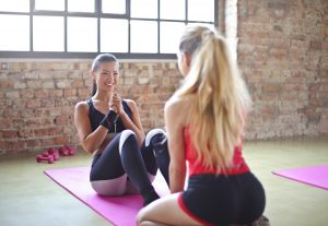 Women in activewear at home gym