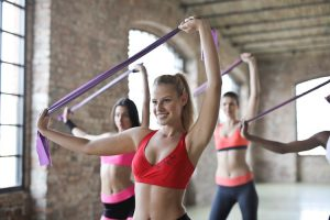 Three women wearing sports bra's in the gym.