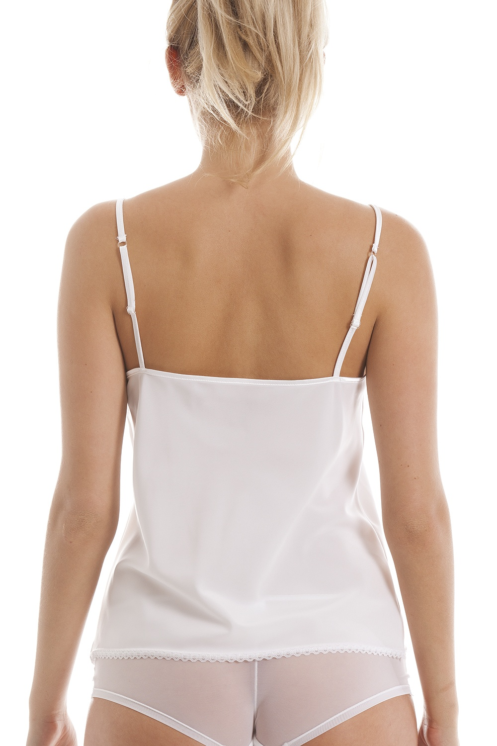 A white cami top or black cami top could be worn together, giving a dual-layered look, or could be worn with other tops with low v-necks of contrasting colors. A red tank top is another